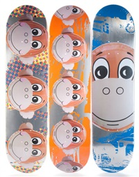 a suite of three monkey train skate decks (3 works) by jeff koons