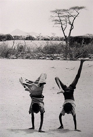 children doing handstands, somalia, 1980 by chris steele-perkins