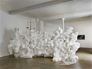 scale of justice carried by shore foam by allora and calzadilla