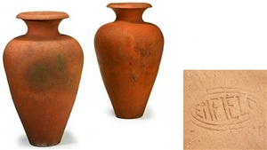 a pair of monumental enfield pottery terra cotta urns
