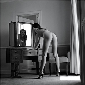 x-portfolio series : petra bending over in front of a mirror by guido argentini