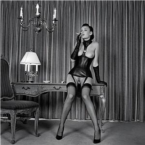x-portfolio series : petra smoking a cigarette with a black corset by guido argentini