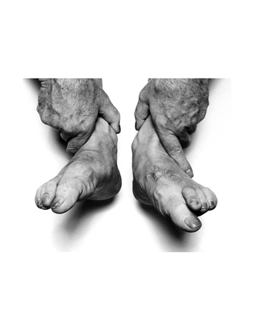 self portrait hands holding feet by john coplans