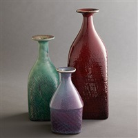 stig lindberg for gustavsberg collection of three bottles glazed stoneware signed with partial decal manufacturer's label to underside of largest example: [gustavsberg]. incised signature and studio mark to underside of each example: [stig l]. by stig lindberg