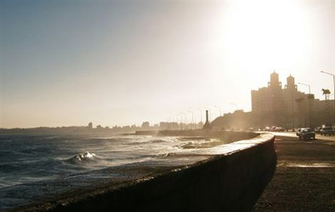the famous malecon, 7:00 am. the lovers have gone home. habana by michael dweck