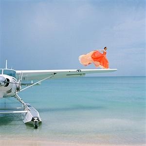 saori on sea plane wing, dominican republic (ref-tro-0610-197--09) by rodney smith