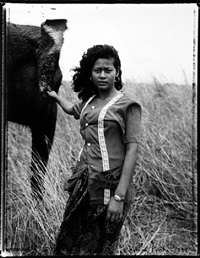 woman and elephant, phnom penh by bill burke