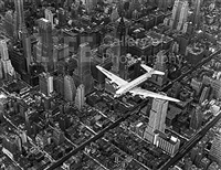 dc-4 flying over new york city by margaret bourke-white