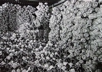 chianti flasks in the storeroom of the bottling plant of barone ricasoli vineyards at brolio, near siena, italy by alfred eisenstaedt