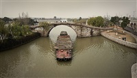 stone bridge & lumber barge seen from moxie rd., suzhou, jiangsu province, prc by philipp scholz rittermann