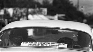 a sign in rear window of car in philadelphia, mississippi by bill eppridge