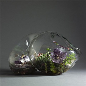 john bingham amorphic glass sculpture, hand blown. made of heavy, thick glass cornucopia-like shape with hollow middle by john bingham