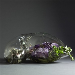 john bingham amorphic glass sculpture, hand blown. made of heavy, thick glass cornucopia-like shape with hollow middle. by john bingham