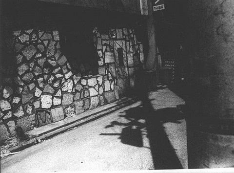 untitled, artist's shadow in alleyway by daido moriyama