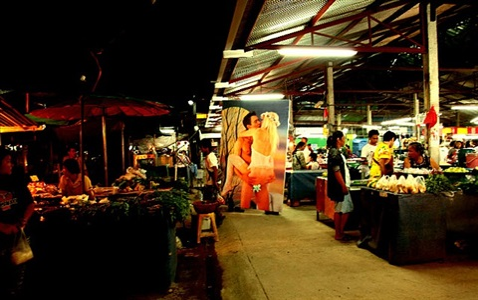 village and elsewhere: jeff koons' wolfman in pakoitai market and sunday market by araya rasdjarmrearnsook
