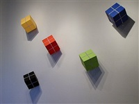 installation view: cube suspended from a single point by william metcalf