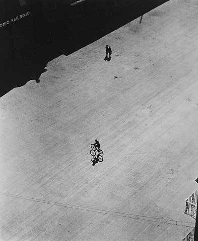 boy on bike below brooklyn bridge by ralph steiner