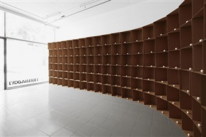 138 prepared dc-motors, cotton balls, cardboard boxes 40x40x40cm by zimoun