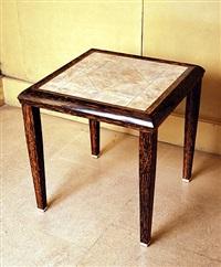 table basse en bois de palmier reposant sur des sabots en ivoire by clement rousseau
