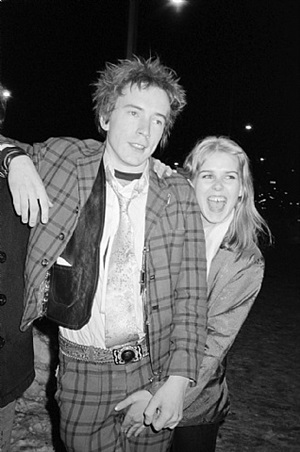 johnny rotten and danielle boothe, in front of cbgb, bowery by bobby grossman