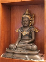 in the form of the buddha (statue, seated)