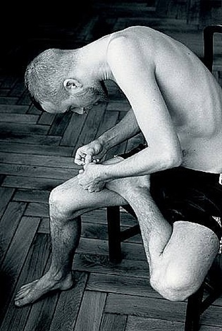 anders pulling splinter from his foot by wolfgang tillmans