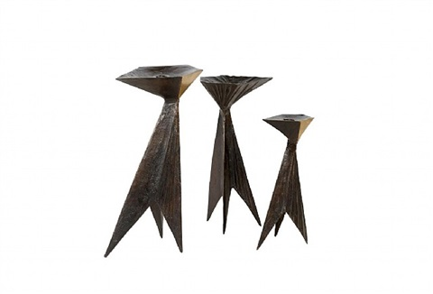 set of three bronze candlesticks by lynn chadwick