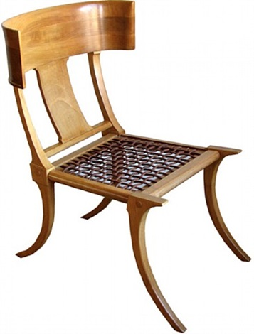 a t.h. robsjohn-gibbings klismos saridis wooden and leather chair by t.h. robsjohn-gibbings