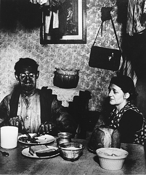northumbrian miner at his evening meal by bill brandt