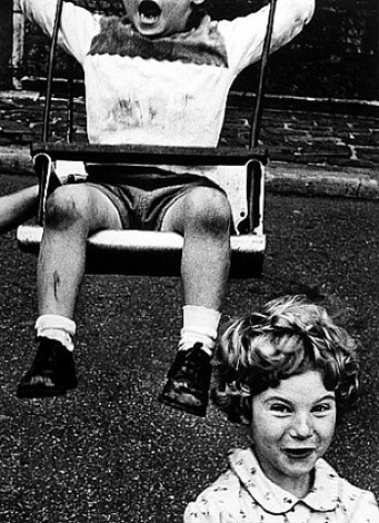 boy + swing + simpering girl, new york by william klein