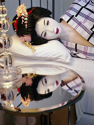 the love doll/day 35 (blue geisha, lying on bed 2) by laurie simmons