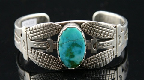 hopi turquoise and silver stamped and appliqué style bracelet with corn motif