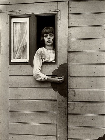 girl in fairground caravan by august sander