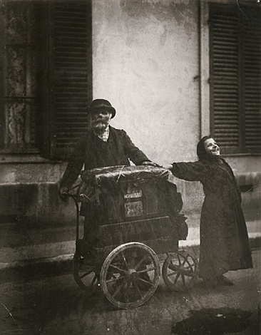 joueur d'orgue (organ-grinder and girl) by eugène atget