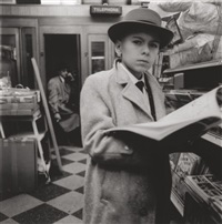 boy reading a magazine, n.y.c by diane arbus