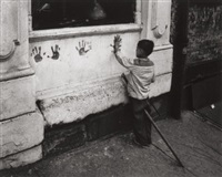 pittsburgh (child putting hand impressions on wall) by w. eugene smith