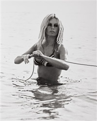 brigitte bardot swimming in st. tropez, france by ron galella
