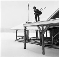 reed skiing off roof, lake placid ny by rodney smith