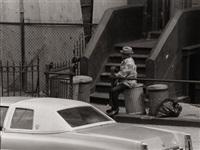man smoking cigar on trashcan by roy decarava
