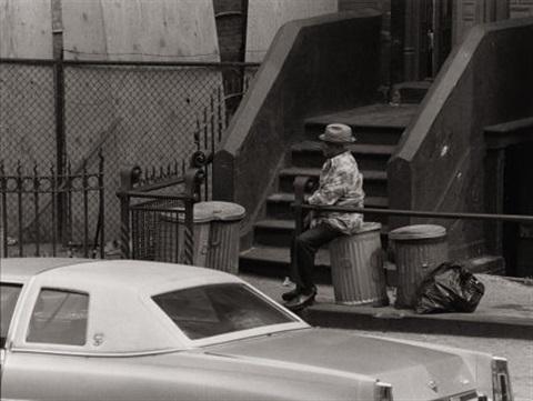 man smoking cigar on trashcan by roy decarava