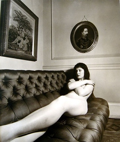 nude on tufted sofa by bill brandt
