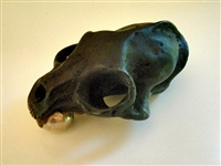 cat skull with egg by kiki smith