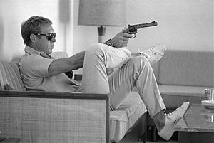 steve mcqueen with pistol by john dominis