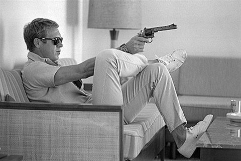 steve mcqueen with pistol by john dominis