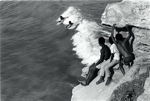 children body surfing off the western cape coast by cedric nunn