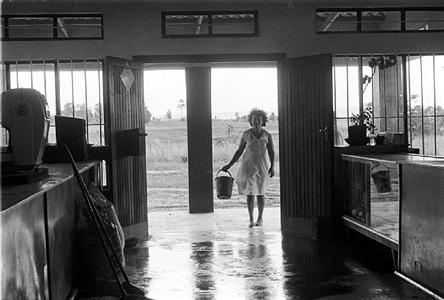 lily nunn mopping her shop by cedric nunn