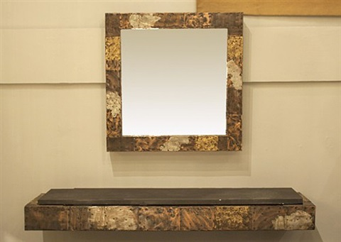 a patchwork floating shelf and mirror by paul evans