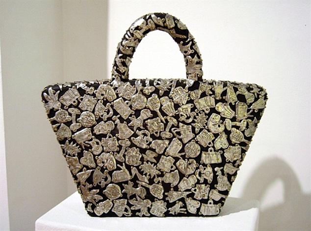 female fetish: handbag by claudia demonte
