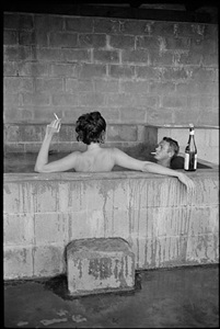 steve mcqueen and his wife, neile adams, taking a sulphur bath at home, california, 1963 by john dominis