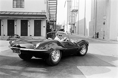 steve mcqueen in black jaguar at studio, california, 1963 by john dominis